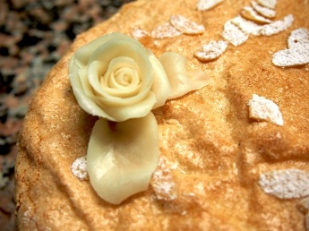Marzipan rose on Dacquoise